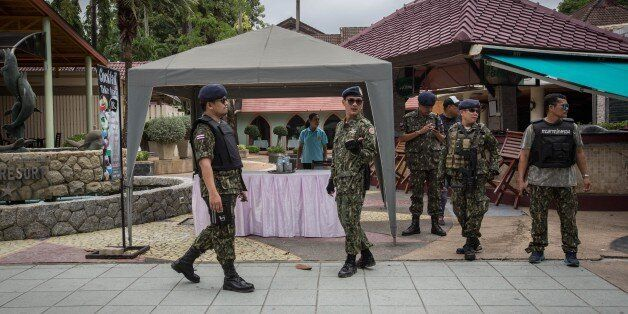 PHUKET, THAILAND - AUGUST 12: Thai security forces stand guard at the scene of a blast near Patong beach...