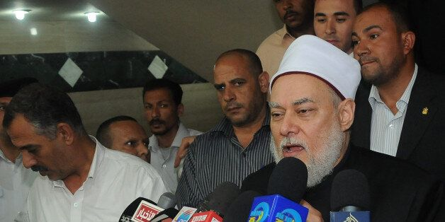 Egyptian Grand Mufti Ali Gomaa holds a press conference in Cairo on April 19, 2012 to clarify the reason...