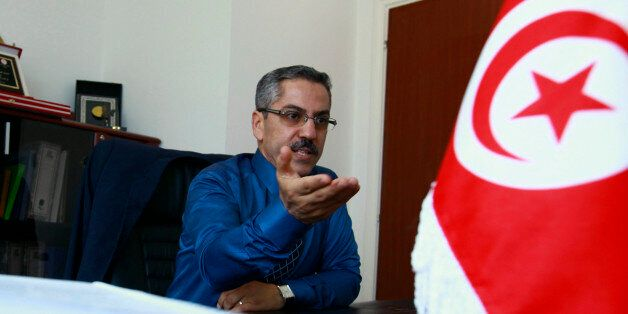 Chafik Sarsar, head of the Instance Superieure Independante pour les Elections (ISIE), speaks during...