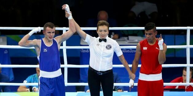 2016 Rio Olympics - Boxing - Preliminary - Men's Light (60kg) Round of 32 Bout 21 - Riocentro - Pavilion...