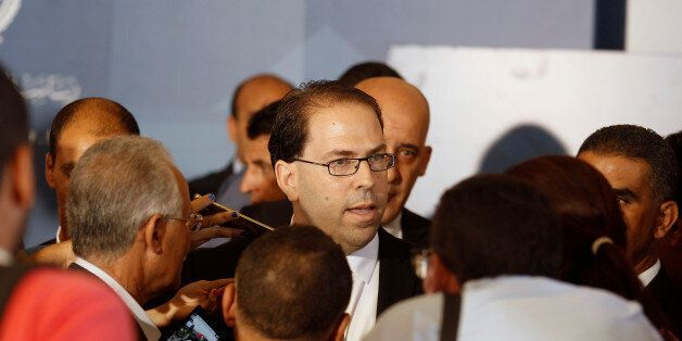 Tunisia's Prime Minister-designate Youssef Chahed speaks to journalists after his meeting with Tunisia's...