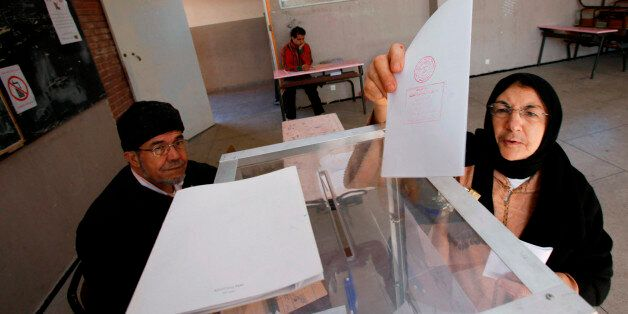 A voter casts her ballot at a polling station in Rabat November 25, 2011. Moroccans voted in a parliamentary...