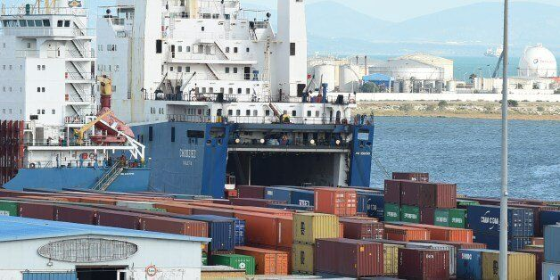 A cargo ship unloads imported goods in the Tunisian port city of Rades on November 12, 2014. The World...