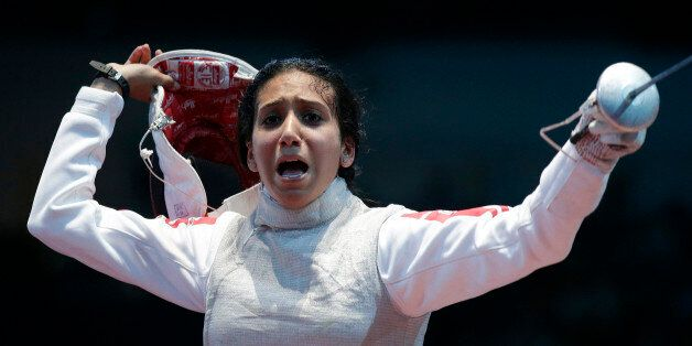 Tunisia's Ines Boubakri celebrates winning against France's Astrid Guyart (not pictured) during their...