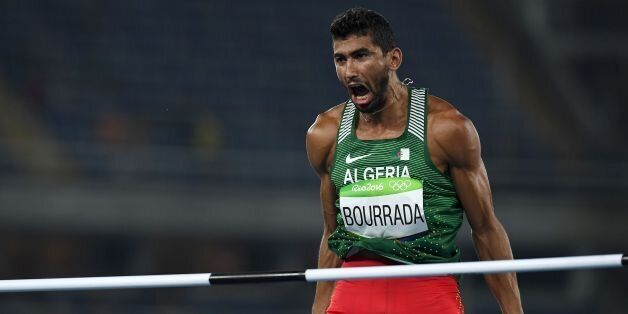 Algeria's Larbi Bourrada reacts as he competes in the Men's Decathlon High Jump during the athletics...
