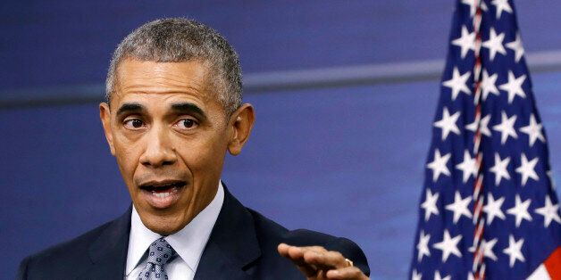 President Barack Obama answers a question during a news conference after attending a National Security...
