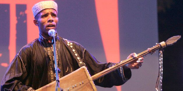 A member of Diwan El Waha of Bechar performs during the Alger Festival Gnaoui in Algiers July 6, 2008....
