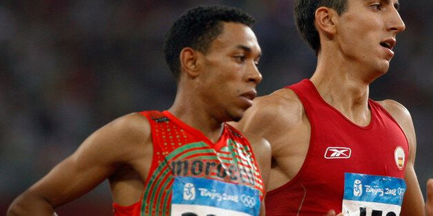 Abdalaati Iguider (L) of Morocco and Arturo Casado of Spain run during their men's 1500m heat in the...