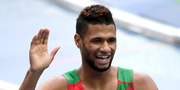 Morocco's Mostafa Smaili waves after competing in the Men's 800m Round 1 heat during the athletics event...