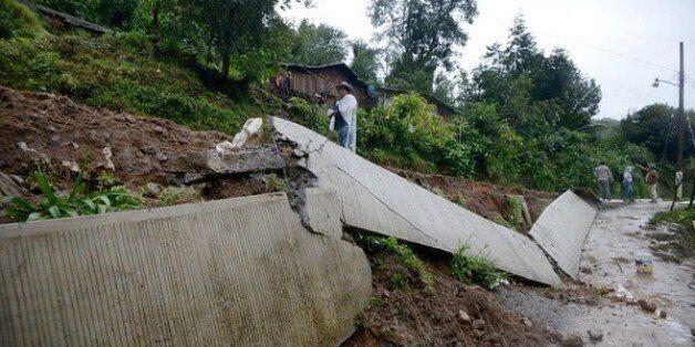 Les dégats provoqués par des glissements de terrains après le passage de la tempête Earl à Coscomatepec...