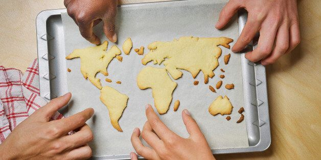 Hands reaching for world map