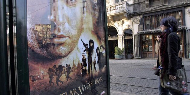 Istanbul, TURKEY: TO GO WITH STORY FILES - A girl walks past a billboard showing the poster of the new...