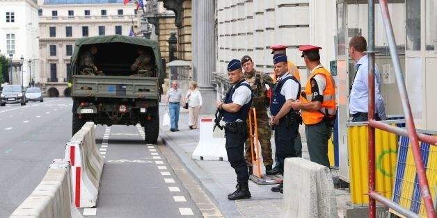 ***BELGIUM OUT***Police and journalists gather outside of the Belgium's Prime Minister's Office in Brussels...