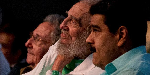Former Cuban leader Fidel Castro (C), Cuba's President Raul Castro (L) and Venezuela's President Nicolas...