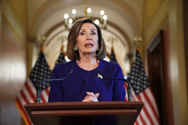 House Speaker Nancy Pelosi of Calif., reads a statement announcing a formal impeachment inquiry into...