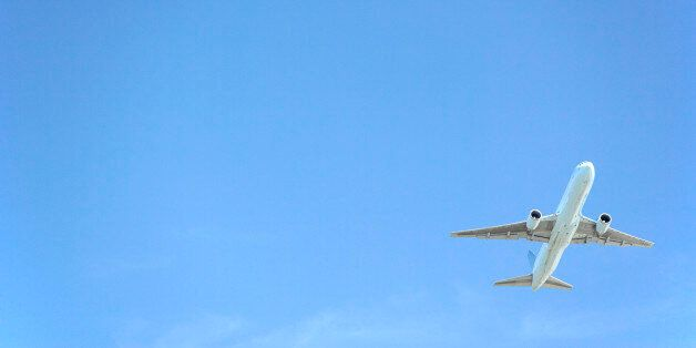 Commercial Airplane Flying Against A Blue