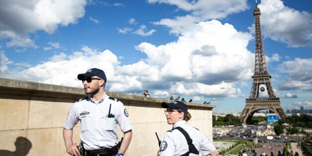 French police officers patrol at Trocadero Plaza next to the Eiffel Tower in Paris, Wednesday, June 15,...