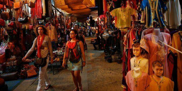 Tourists stroll between shops in Rue des Consuls in Rabat's Medina September 25, 2014. UNESCO made Rabat...