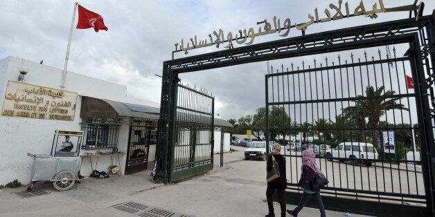 Tunisian students arrive at the Manouba University on January 17, 2013 outside Tunis. The dean of the...