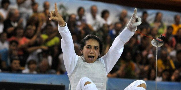 Tunisia's Ines Boubakri celebrates her bronze medal in the women's individual foil event, at the Mediterranean...