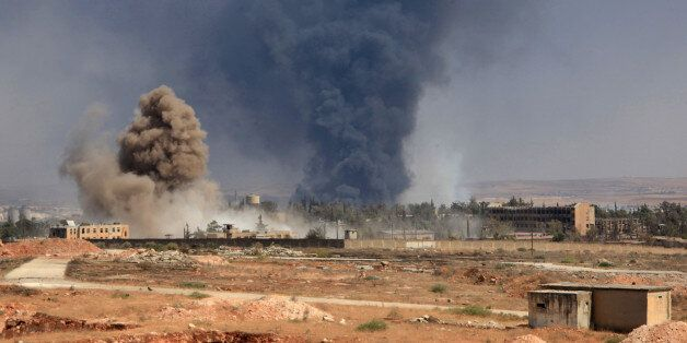 Smoke billows following air strikes by regime forces on rebel positions during intense fighting in Aleppo...