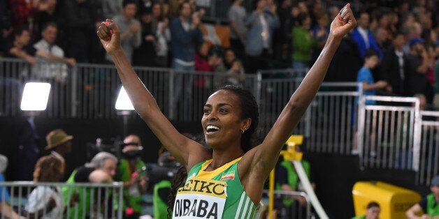 Ethiopia's Genzebe Dibaba celebrates winning the 3000 meters final at the IAAF World Indoor athletic...