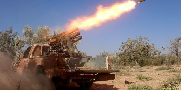 ALEPPO, SYRIA - AUGUST 08: Members of the Syrian oppositions launch rocket attack to military headquarters...