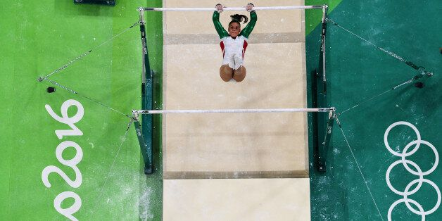 RIO DE JANEIRO, BRAZIL - AUGUST 07: Farah Boufadene of Algeria competes on the uneven bars during Women's...