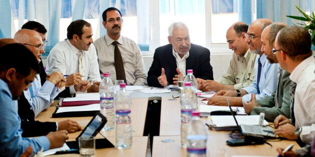 Tunisian leader and founder of the moderate islamist party Ennahda, Rached Ghannouchi, center right,...