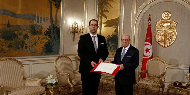 President Beji Caid Essebsi (R) meets with Prime Minister-designate Youssef Chahed in Tunis,Tunisia August...