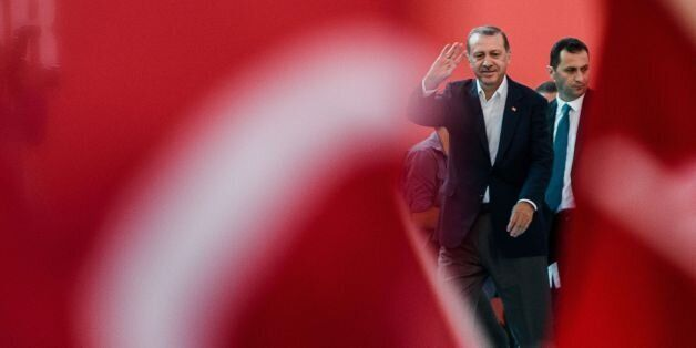 Turkish President Recep Tayyip Erdogan (C) greats supporters on August 7, 2016 in Istanbul during a rally...