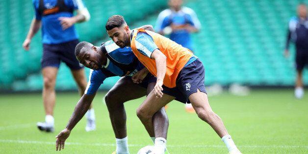 GLASGOW, SCOTLAND - JULY 22: Riyad Mahrez battles Wes Morgan during the Leicester City Training and Press...