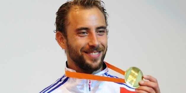 Silver medalist France's Victor Sintes poses on the podium of the Men's Foil competition at the 2011...