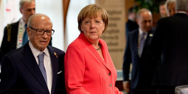 German chancellor Angela Merkel , right, and Tunisia's President Beji Caid Essebsi. wait prior to a working...