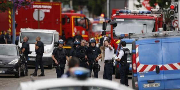French police officers and fire engine arrive at the scene of a hostage-taking at a church in Saint-Etienne-du-Rouvray,...