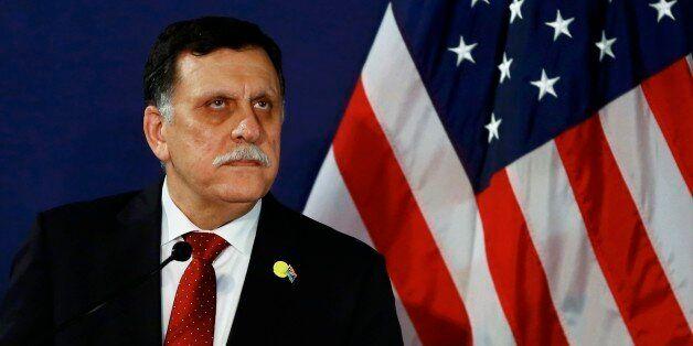 FILE - In this May 16, 2106 file-pool photo, Fayez al-Sarraj, the head of the U.N.-brokered presidency...