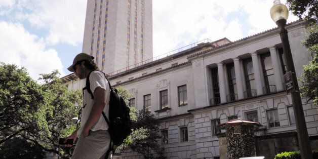 FILE PHOTO -- A student walks at the University of Texas campus in Austin, Texas, June 23, 2016. The...
