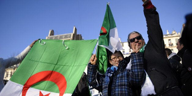 People hold Algerian flags on January 22, 2011 in Marseille, southern France, in support of local pro-democracy...