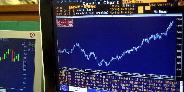 ** FILE ** The Bombay stock exchange index sensex graph is seen on the terminal of a stock broker's terminal,...