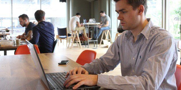 Frank Bertele, CEO of tech startup NETZ, works on his laptop in London Wednesday June 29, 2016. Within...