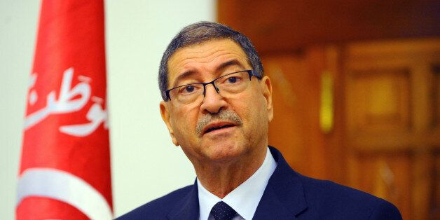 Tunisian Premier Habid Essid addresses the media following a cabinet meeting in Tunis, Tuesday, Match...