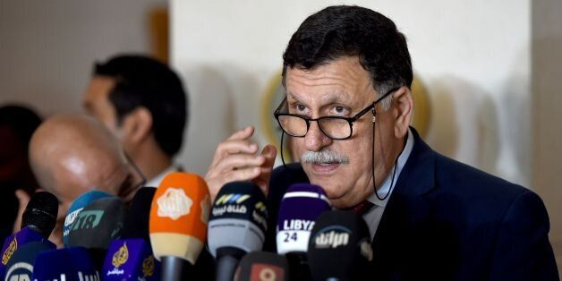 Libyan Prime Minister Fayez al-Sarraj speaks during a press conference following his meeting with representatives...