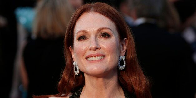 Presenter Julianne Moore wearing a black Chanel gown with beaded embellishments, arrives at the 88th...