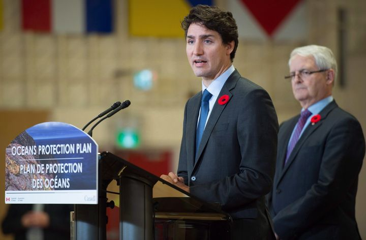 Prime Minister Justin Trudeau announces a $1.5-billion national Oceans Protection Plan as Transport Minister Marc Garneau listens, at HMCS Discovery in Vancouver, B.C., on Nov, 7, 2016.