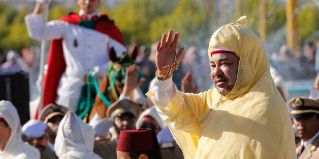 Morocco's King Mohammed VI waves to the crowd as he stands in a limousine during a ceremony of allegiance,...