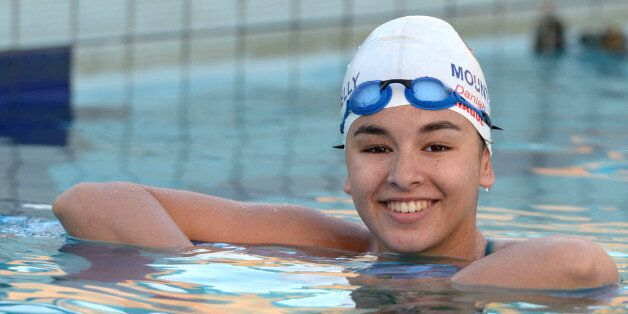 Libyan swimmer Daniah Hagul, 17, poses for a picture as she trains at the national pool in Msida, Malta,...