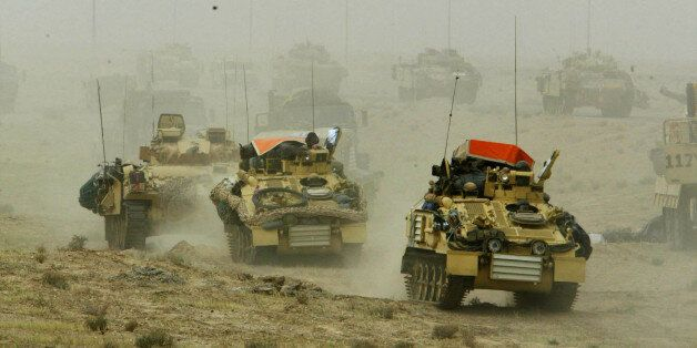 A British army armoured vehicle convoy rolls into southern Iraq March 22, 2003. Picture taken March 22,...