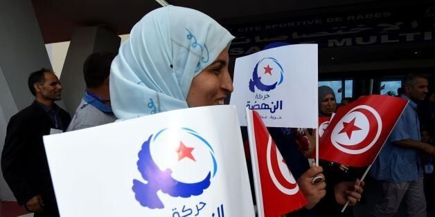 Supporters of Tunisia's Islamist Ennahdha Party wave the national and party flags on May 20, 2016 during...