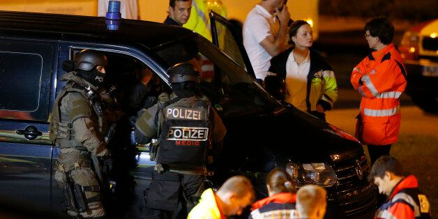 Special force police officers stand in front of a car near the Olympia shopping mall, following a shooting...