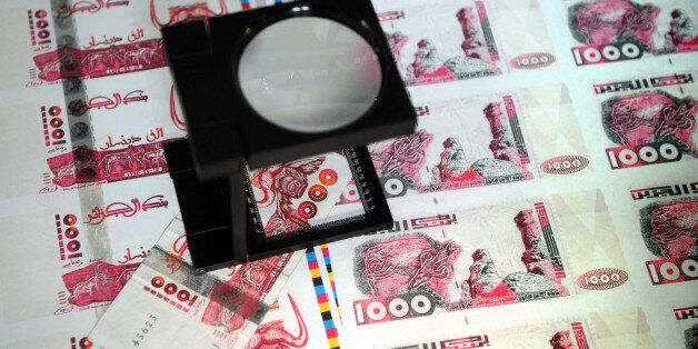A picture taken on October 26, 2009 in Lyon, central France shows plates of false printed Algerian Dinar...
